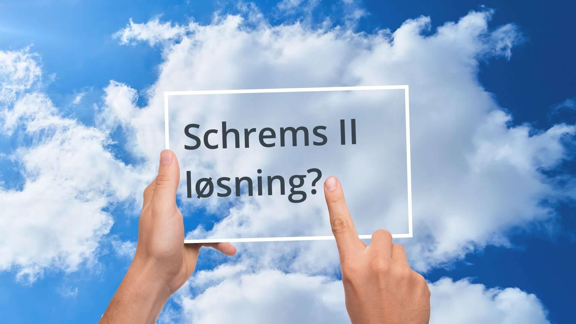 Schrems II løsning skrevet i ramme mot blå himmel med skyer